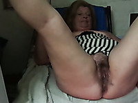 Slutty blond haired mature lady exposed her bum and fingered her cunt