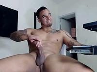 This dude with a bunch of tattoos loves jerking off and cumming on webcam