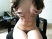 Busty white sweetheart in front of webcam opening her legs