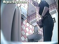 Sweet tall blonde woman in the public restroom for ladies filmed on cam