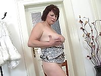 Redhead buxom amateur mature MILF Dalia strips and masturbates