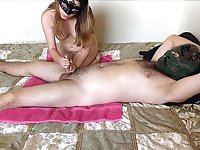 Kinky amateur makes her BF wear a mask and she is a good handjob giver