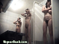Lean brunette college girl with hairy quim filmed in the shower room