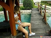 Smutty blonde enjoys fingering her pussy outdoors