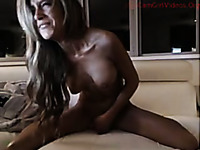 Sexy naked babe is fingering her snatch and riding a dildo like a total slut