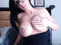 Big breasted tattooed webcam nympho played with tits and her toy