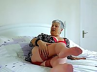Grandma is stripping down seductively teasing with her sexy body