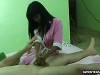 Cute Asian girlfriend enjoys playing with boyfriend's dick