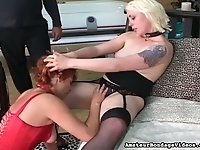 Red haired chick and blond whore lick each others pussies