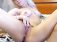 Busty blonde girl having fun with dildo in both holes