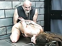 Old fart is punishing young sweetie which is tied up and restrained