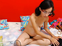 Slender nerdy and shy looking cam brunette gets busy with teasing her wet cunt