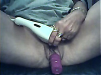 Amateur lady masturbates her wet pussy with a dildo for pleasure portion
