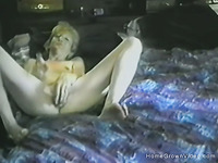Amateur blonde mature toys her pussy in bed
