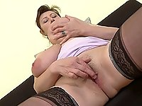 Buxom MILF Jana P. licks and plays with her humongous boobs
