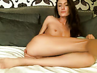 Alluring flat chested and leggy sensual romantic babe fucks with dildo