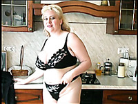 Blonde mature Russian lady in the kitchen poses naked on cam