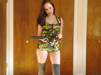 Natural wild long haired brunette in sexy camouflage uniform used toy