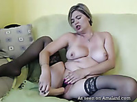 Naughty and mature blondie on the couch masturbates and squirits on webcam