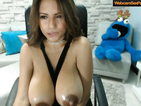 Hot latina with massive tits plays on web camera