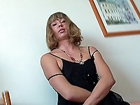 Andrea massages her clit before plowing it with a toy