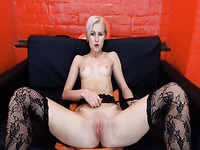 Tall svelte and long legged blonde in black stockings uses toy for solo
