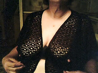 Amateur mature short haired bitch in knitted black nightie shows huge tits