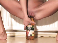 Skinny amateur friend stretching her vagina with Coke bottle