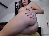 Buxom MILF shows off her body in all its glory as she masturbates on cam