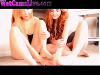 Two webcam lesbians stroking dildo with their sexy feet
