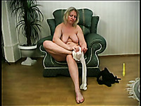 Amateur blonde lady gets rid of stockings and exposes super saggy tits