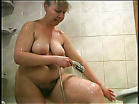 Amateur natural housewife with blond hair and big tits is in the shower