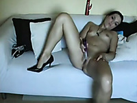 Slender and quite buxom dark haired webcam bitch is fond of solo show