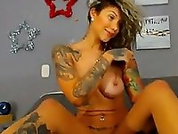Tattooed babe dances and shows off what she got on cam