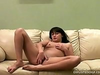 Just ordinary amateur bitch with dark hair masturbates her wet pussy