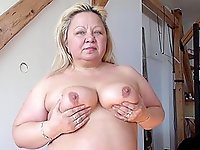 Older chubby mom is stripping down showing her beautiful body