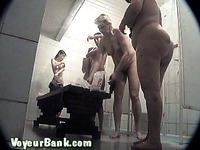 A big group of amateur white ladies nude in the public shower room