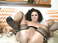 Curly short haired pretty webcam model in black stockings used huge toy