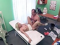 Blonde woman leaves her physician to check her pussy with his dick